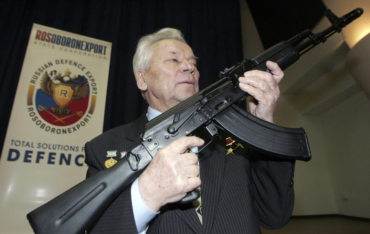 Mikhail Kalashnikov, chief designer of Izhmash Concern, a Russian firearms producer, poses with the latest model of his rifle during a news conference in Moscow in this April 15, 2006 file photo. Kalashnikov, the designer of the assault rifle that has killed more people than any other firearm in the world, died on December 23, 2013, at 94, Russian state news agency Itar-Tass reported. REUTERS/Sergei Karpukhin/Files (RUSSIA - Tags: MILITARY PROFILE)