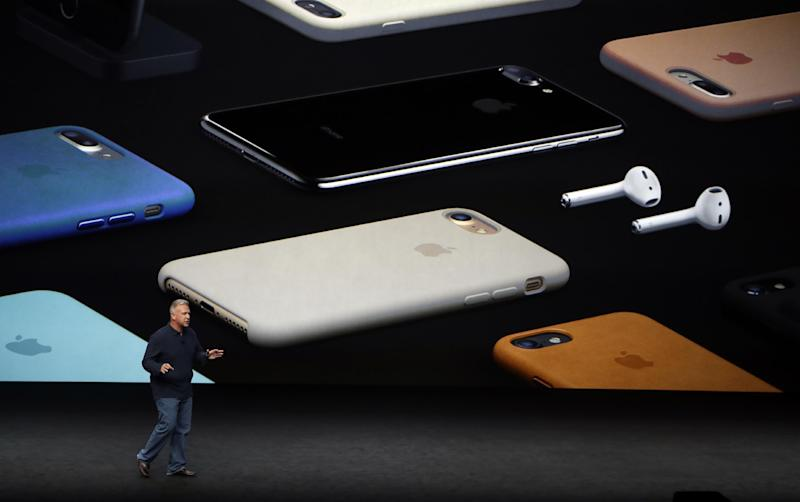 FILE - In this Sept. 7, 2016, file photo, Phil Schiller, Apple's senior vice president of worldwide marketing, talks about the pricing on the new iPhone 7 during an event to announce new products, in San Francisco. Eliminating the headphone jack doesn't seem to have hurt sales of the iPhone 7, which appears poised to reverse Apple's recent sales slide. Though not by much, which leaves a question that's shadowed the company for nearly a year: What's its next act? (AP Photo/Marcio Jose Sanchez, File)