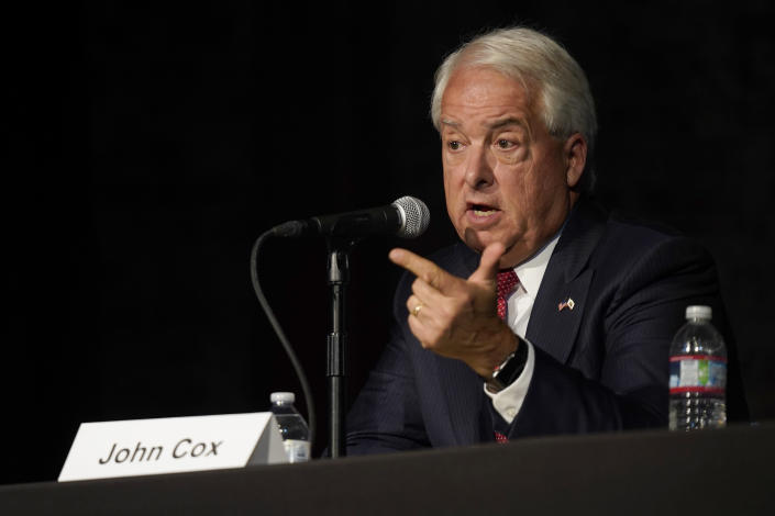 In this Aug. 17, 2021 file photo Republican gubernatorial candidate John Cox, right, responds to a question during a debate held by the Sacramento Press Club in Sacramento, Calif. Cox is running to replace Democratic Gov. Gavin Newsom in the Sept. 14 recall election. Democrats hope hope they can keep Newsom in office by driving up turnout.(AP Photo/Rich Pedroncelli, File)