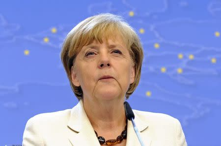 Germany's Chancellor Merkel holds a news conference after a EU summit in Brussels