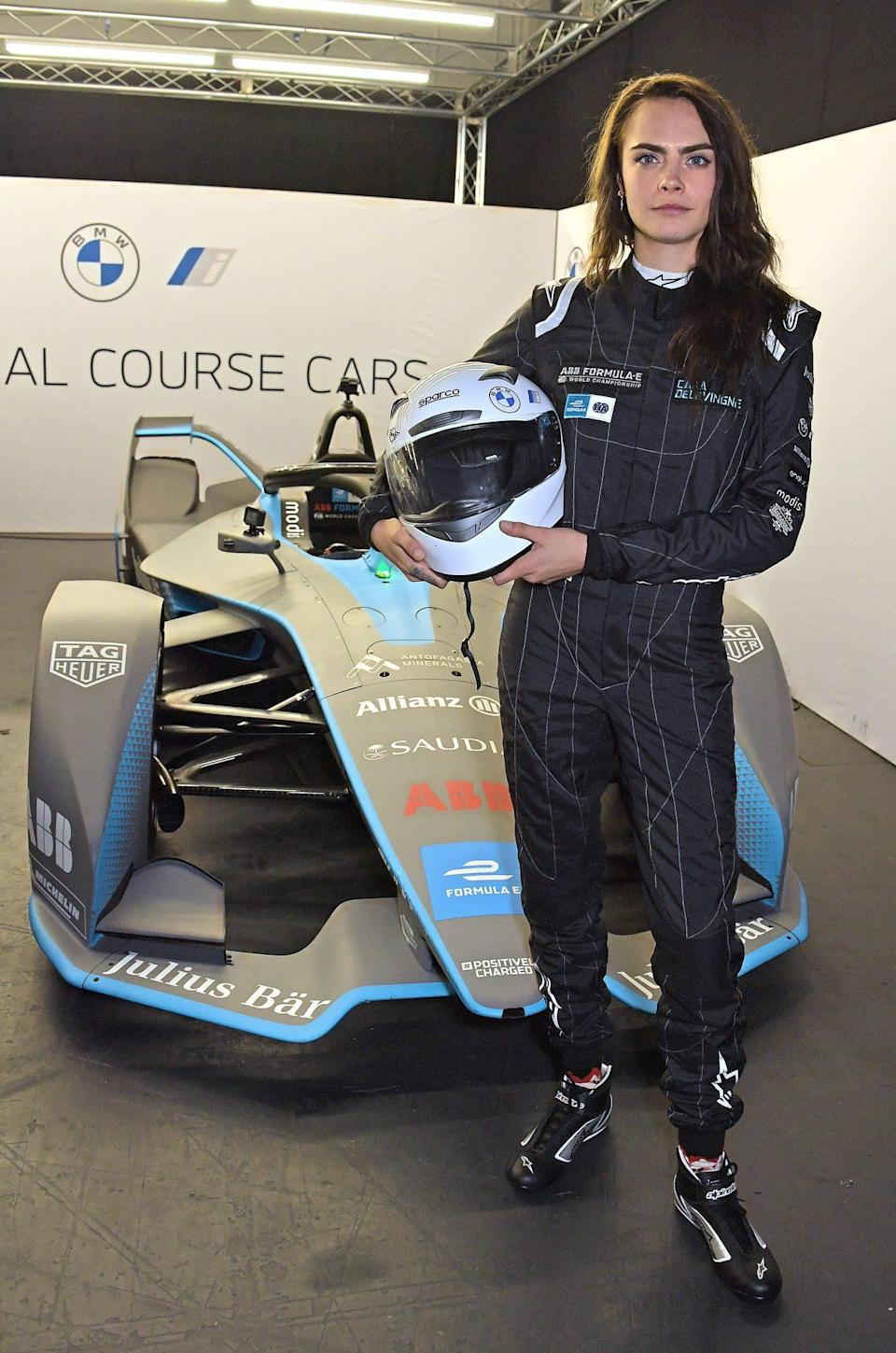 <p>Cara Delevingne poses at the ABB FIA Formula E Heineken London E-Prix at ExCel on July 24 in London.</p>
