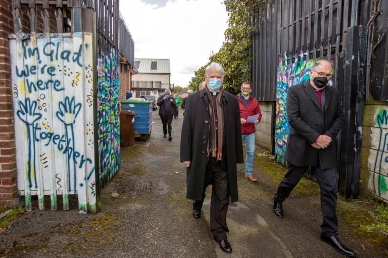 Catholic Bishop Noel Trainor (L) walks with Protestant Bishop George Davidson as they join other church leaders at Forthspring Inter Community Group, at the peace line in West Belfast, Northern ireland, to pray for the violence to end