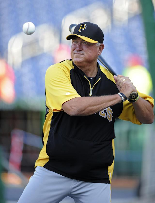 In this July 23, 2013, photo, Pittsburgh Pirates manager Clint Hurdle hits balls during batting practice before the Pirates' baseball game against the Washington Nationals in Washington. Hurdle has won the NL Manager of the Year award after guiding the Pirates to the playoffs in their first winning season since 1992. (AP Photo/Nick Wass)