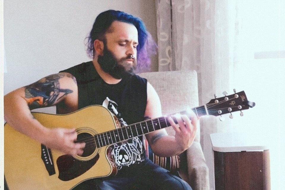 Justin Coffman, the bassist in a punk rock band, is facing felony charges after posting images from an album photo shoot. (Photo: Courtesy of Leah Harris)