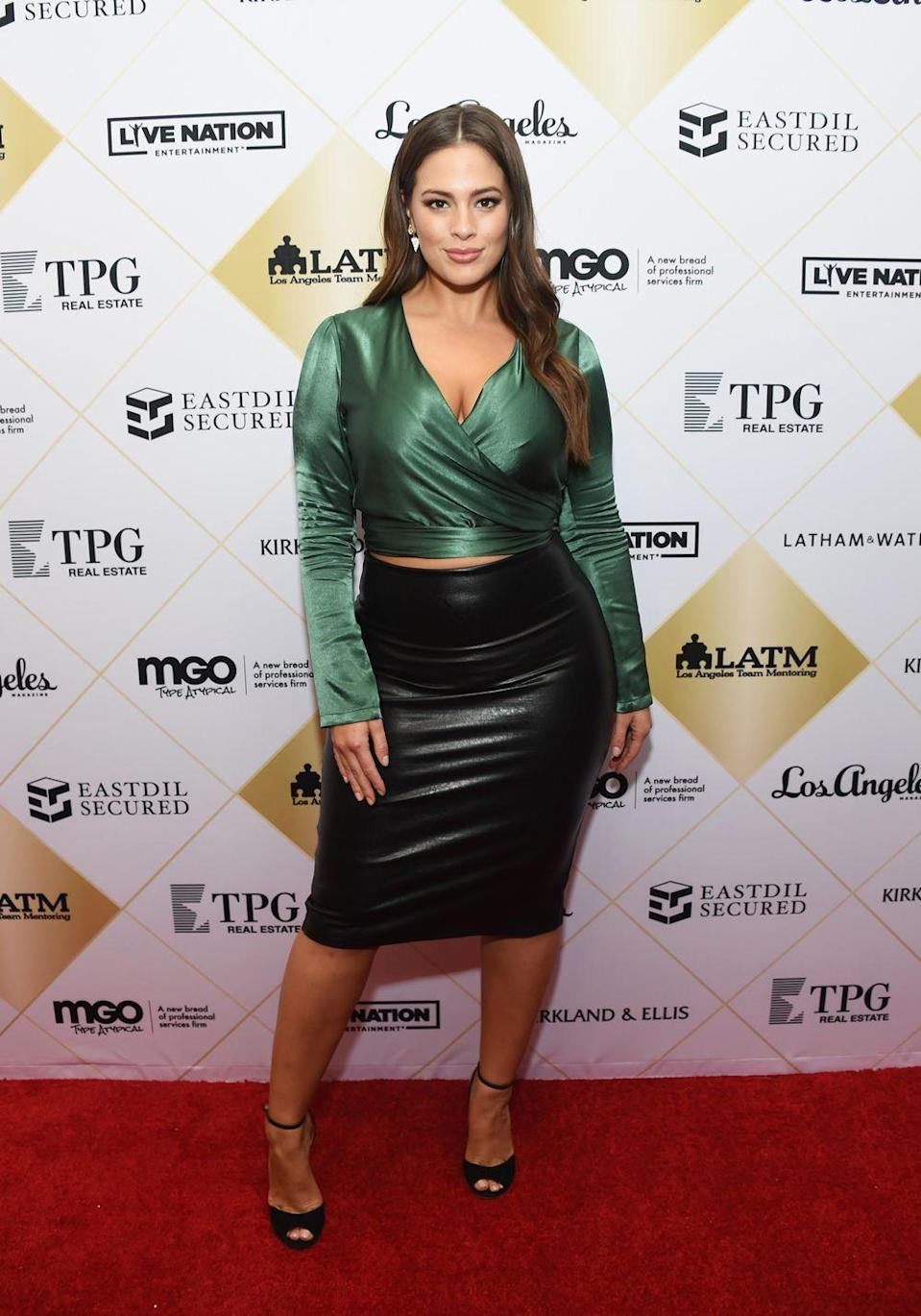 <p>Attending an event in LA: Looking like the hottest woman to ever walk planet earth. Ashley floored us with this black leather midi skirt and emerald green silk wrap shirt. We will be attempting to replicate this outfit immediately.</p>