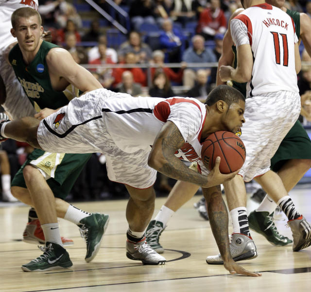 Louisville forward Chane Behanan, center, grabs a loose ball in front of Colorado State forward Pierce Hornung (4) in the first half of a third-round NCAA college basketball tournament game on Saturday, March 23, 2013, in Lexington, Ky. (AP Photo/John Bazemore)