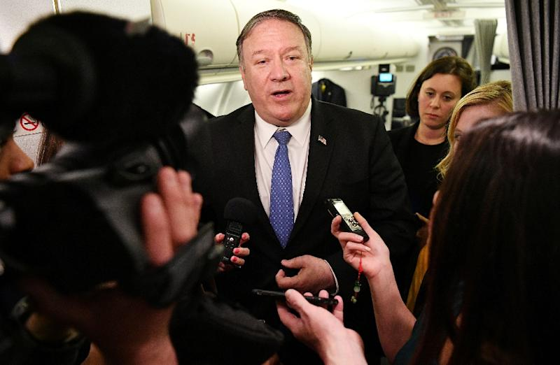 US Secretary of State Mike Pompeo speaks to reporters in flight after a previously unannounced trip to Baghdad (AFP Photo/MANDEL NGAN)
