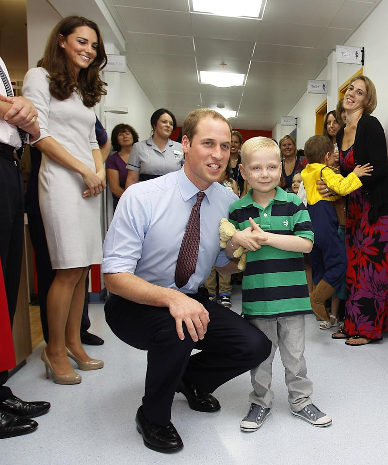 LONDON, UNITED KINGDOM - SEPTEMBER 29: Prince William, Duke of Cambridge meets patient Ellis Andrews, during a visit with Catherine, Duchess of Cambridge to open the new Oak Centre for Children and Young People at The Royal Marsden Hospital on September 29, 2011 in London, England. (Photo by Kirsty Wigglesworth - WPA Pool /Getty Images)