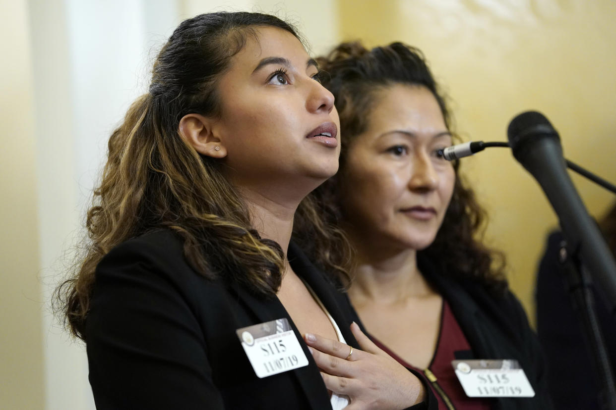 Liane Taracena, left, is embraced by her mother Juana Villanueva, while speaking at a press conference about DACA at the Capitol. (Photo: Win McNamee/Getty Images)