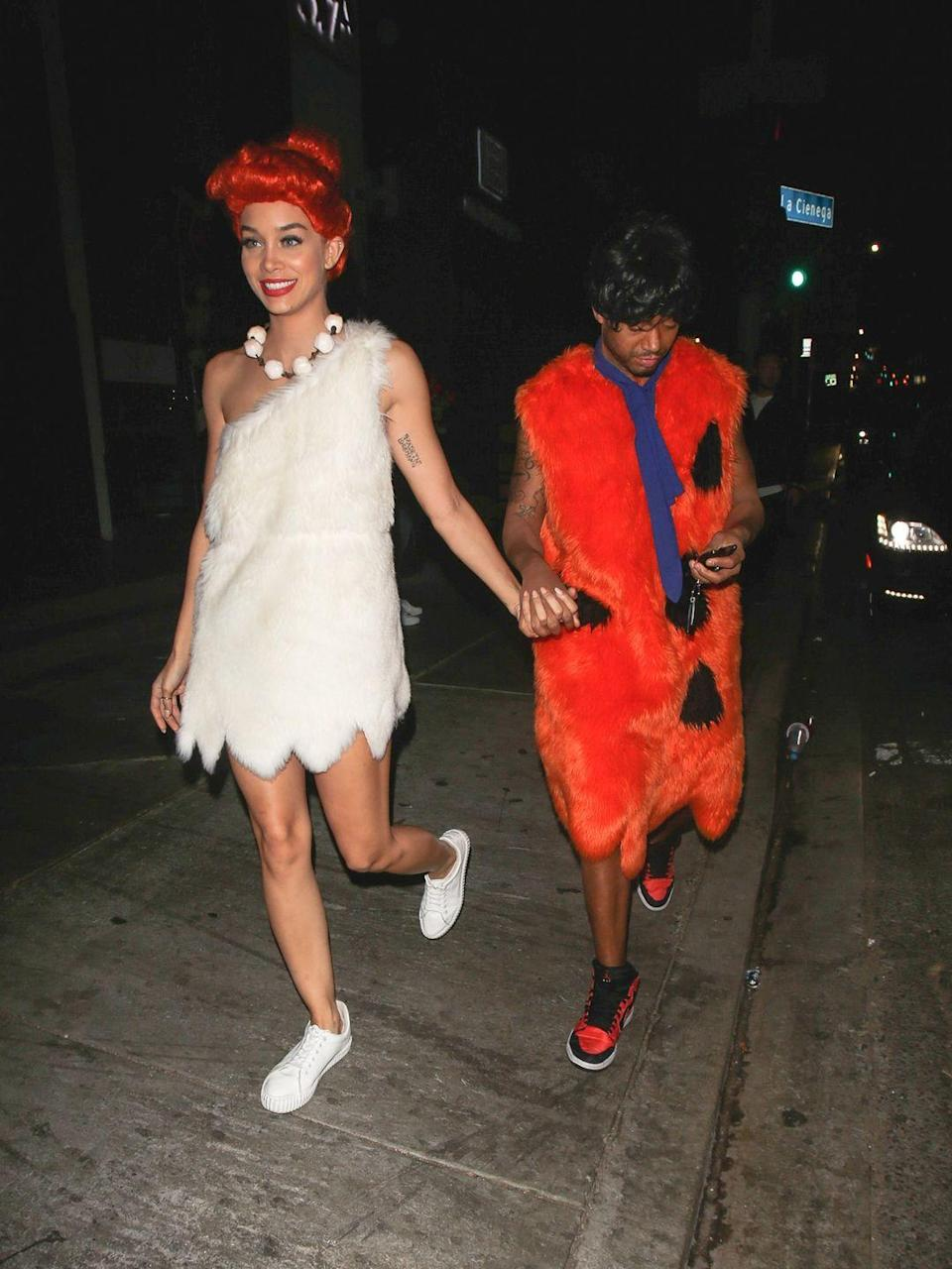 <p>Terrence J and Jasmine Sanders traveled back to pre-historic time to embody the cartoon characters from <em>The Flintstones</em> for Halloween. Yabba dabba doo!</p>