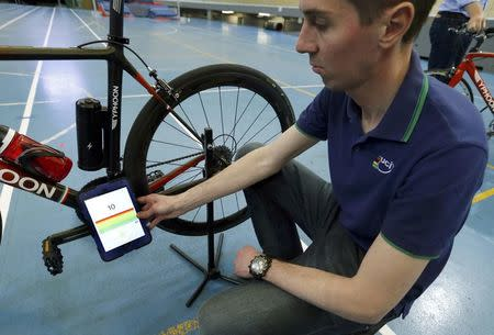 Johan Kucaba, Equipment Coordinator at UCI holds a tablet using magnetic resonance technology to detect a bike equipped with a motor during a media event at the Union Cycliste Internationale (UCI) in Aigle, Switzerland May 3, 2016. REUTERS/Denis Balibouse  TPX IMAGES OF THE DAY