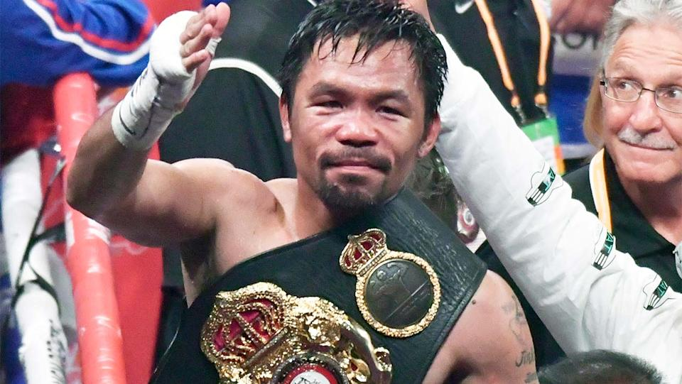 Manny Pacqiauo (pictured) thanking the crowd after winning a boxing match.