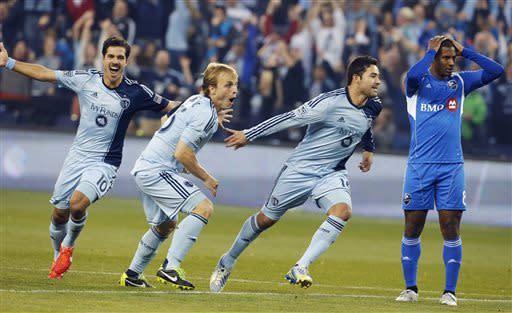 Sporting KC players Benny Feilhaber (10) and Seth Sinovic (15) celebrate a goal by Claudio Bieler (16), next to Montreal Impact midfielder Patrice Bernier (8) during the first half of an MLS soccer match in Kansas City, Kan., Saturday, March 30, 2013. (AP Photo/Orlin Wagner)