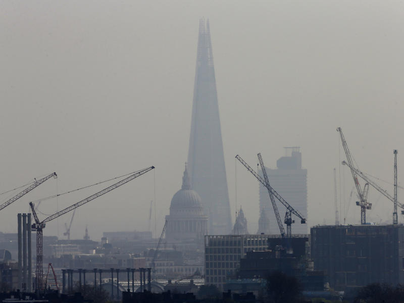 Smog surrounds The Shard, western Europe's tallest building, and St Paul's Cathedral in London: Reuters