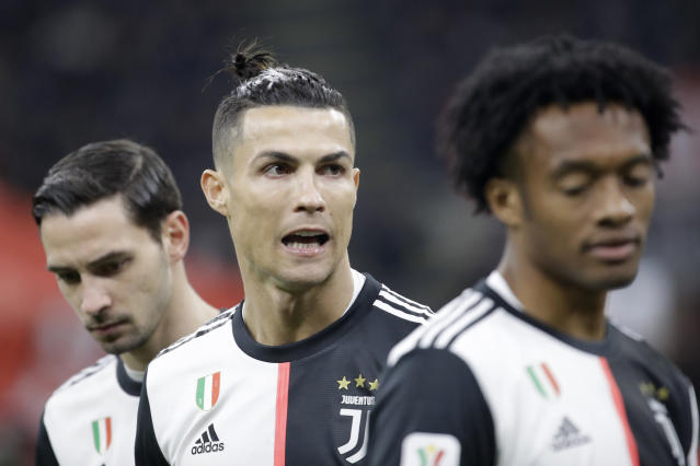 Juventus' Cristiano Ronaldo, center, gestures prior an Italian Cup soccer match between AC Milan and Juventus at the San Siro stadium, in Milan, Italy, Thursday, Feb. 13, 2020. (AP Photo/Luca Bruno)