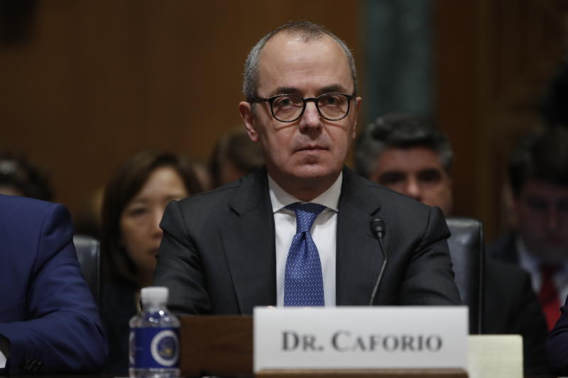 Giovanni Caforio, M.D., Chairman of the Board and Chief Executive Officer Bristol-Myers Squibb Co., prepares to testify before the Senate Finance Committee hearing on drug prices, Tuesday, Feb. 26, 2019 on Capitol Hill in Washington. (AP Photo/Pablo Martinez Monsivais)
