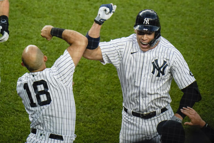 New York Yankees' Aaron Judge, right, celebrates with teammate Rougned Odor after hiting a two-run home run during the fourth inning of the second game of a baseball doubleheader Thursday, May 27, 2021, in New York. (AP Photo/Frank Franklin II)