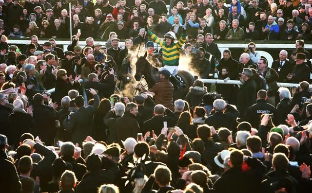 Tony McCoy enters the parade ring aboard Carlingford Lough after winning the Hennessy Gold Cup at Leopardstown. The 2010 BBC Sports Personality of the Year retired later in 2015 having been champion jockey a record 20 consecutive times (Brian Lawless/PA)
