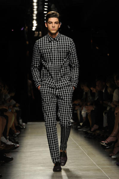 A model wears a creation for the Bottega Veneta men's Spring-Summer 2014 collection, part of the Milan Fashion Week, unveiled in Milan, Italy, Sunday, June 23, 2013. (AP Photo/Giuseppe Aresu)