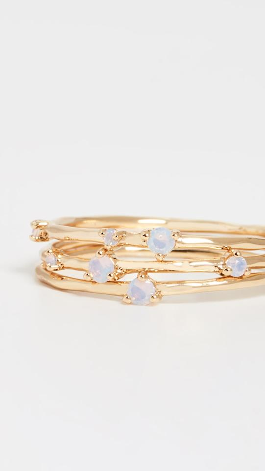 "<p>You can play around with stacking this <a href=""https://www.popsugar.com/buy/Gorjana-Cleo-Ring-Set-483595?p_name=Gorjana%20Cleo%20Ring%20Set&retailer=shopbop.com&pid=483595&price=50&evar1=fab%3Aus&evar9=30647566&evar98=https%3A%2F%2Fwww.popsugar.com%2Ffashion%2Fphoto-gallery%2F30647566%2Fimage%2F46532560%2FGorjana-Cleo-Ring-Set&list1=shopping%2Cjewelry%2C50%20under%20%2450&prop13=mobile&pdata=1"" rel=""nofollow"" data-shoppable-link=""1"" target=""_blank"" class=""ga-track"" data-ga-category=""Related"" data-ga-label=""https://www.shopbop.com/cleo-ring-set-gorjana/vp/v=1/1518646078.htm?folderID=13539&amp;fm=other-shopbysize-viewall&amp;os=false&amp;colorId=14F9C"" data-ga-action=""In-Line Links"">Gorjana Cleo Ring Set</a> ($50).</p>"