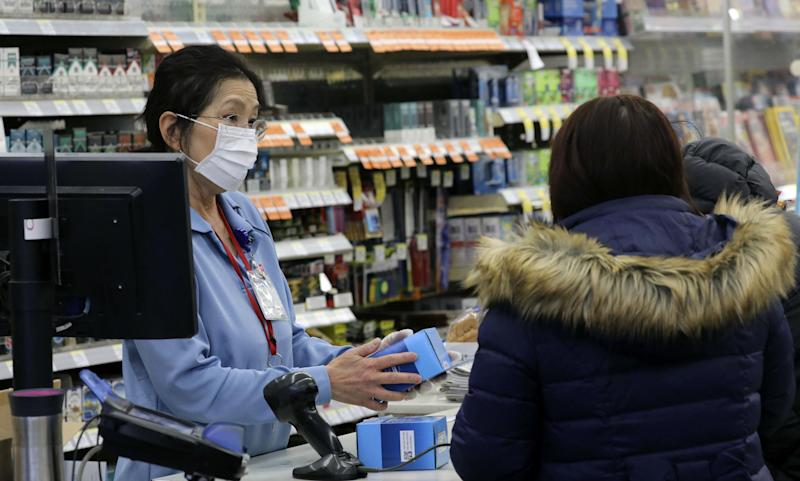 People in Chicago bought face masks after the US's second case was confirmed there: AP