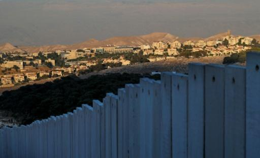 Israel's controversial separation barrier stands before the Israeli settlement of Maale Adumim in the occupied West Bank