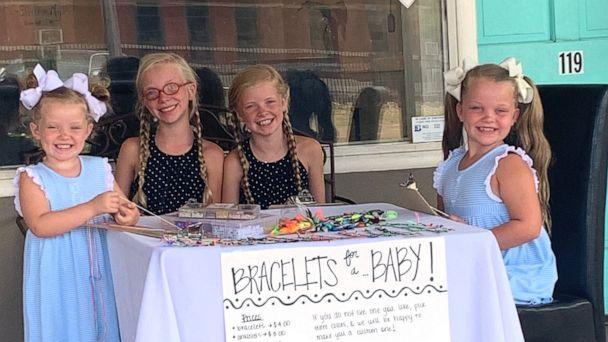 PHOTO: Evelyn, 4, Susanna, 11, Mary Anson, 11 and Eleanor Tate, 7, sit outside their mother's Mississippi salon making and selling bracelets in hopes to raise money so their parents can adopt a baby. (Sidney Tate )