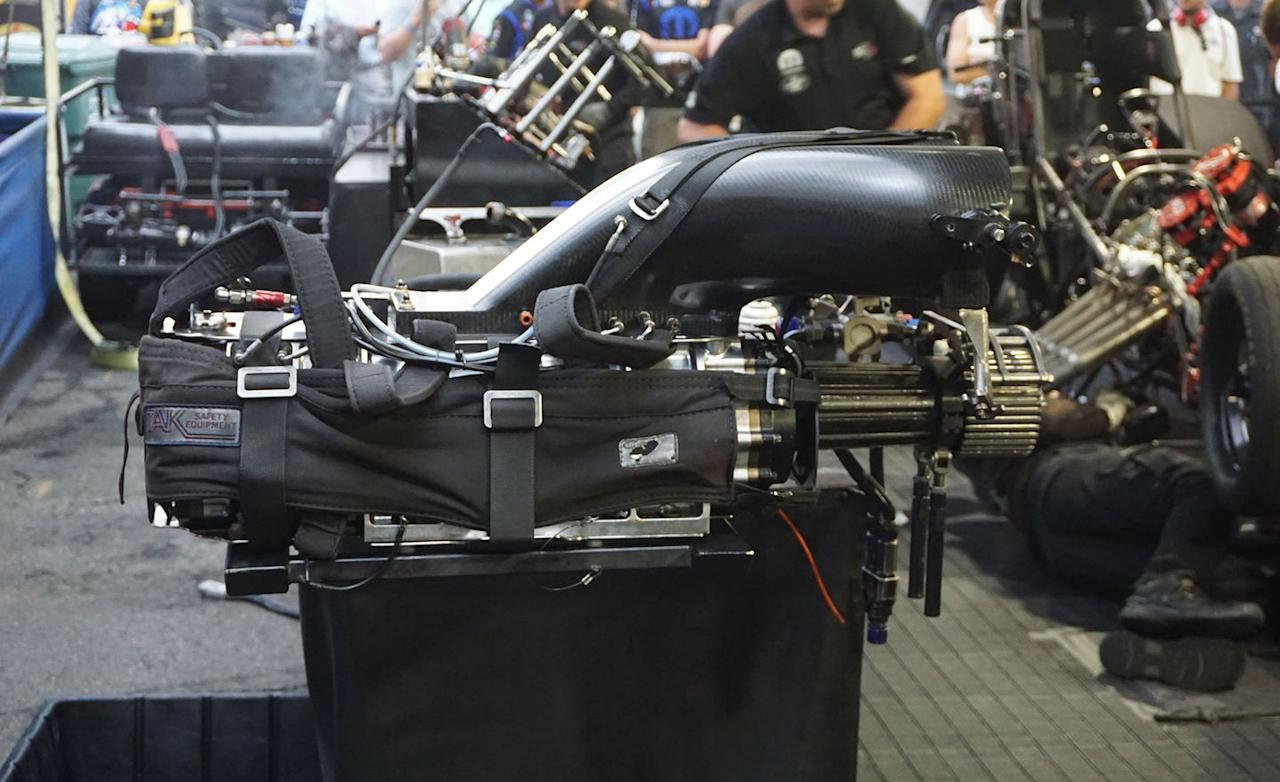 <p>When drag racers first started fitting superchargers to their engines, they repurposed Roots-type blowers originally developed by General Motors for a line of pre-World-War-II-era two-stroke diesel heavy-equipment engines. Those 6-71 blowers, so named because they force-fed six 71-cubic-inch cylinders, have evolved into the purpose-built 14-71 blowers used today (GM, by the way, never built a 14-cylinder engine). The blower uses 19-inch-long rotors nearly six inches in diameter to pump some 548 cubic inches (nearly nine liters!) of air per revolution. That's nearly four times the throughput of a Hellcat supercharger. Running at about 40 percent higher rpm than the engine crankshaft, the supercharger develops about 55 psi of boost pressure. At full power, the supercharger requires the better part of 1000 horsepower to do its work. Obviously, it gives back more horsepower in return.</p>