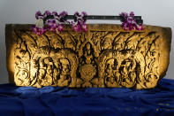 A lentil originally from the Nong Hong Sanctuary in Thailand is displayed during a ceremony to return it and another stolen hand-carved sandstone lintel dating back to the 9th and 10th centuries to the Thai government Tuesday, May 25, 2021, in Los Angeles. The 1,500-pound (680-kilogram) antiquities had been stolen and exported from Thailand — a violation of Thai law — a half-century ago, authorities said, and donated to the city of San Francisco. They had been exhibited at the San Francisco Asian Art Museum. (AP Photo/Ashley Landis)