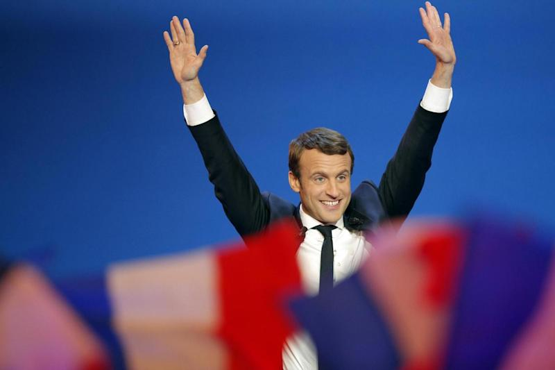 Front-runner: Emmanuel Macron waves before addressing his supporters (AP)