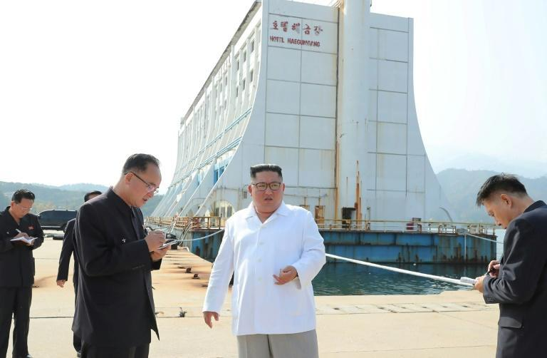 North Korean leader Kim Jong Un (C) in 2019 described facilities at the Mount Kumgang tourist area as 'shabby' and ordered their removal