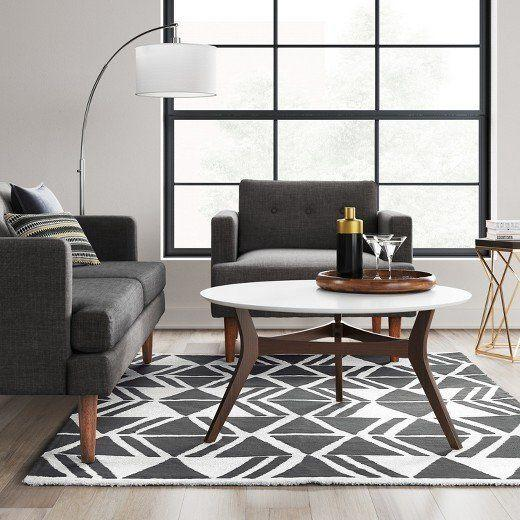"""<a href=""""https://www.target.com/p/charcoal-white-microplush-geo-area-rug-project-62-153/-/A-52899892#lnk=newtab"""" target=""""_blank"""">Shop it here</a>."""