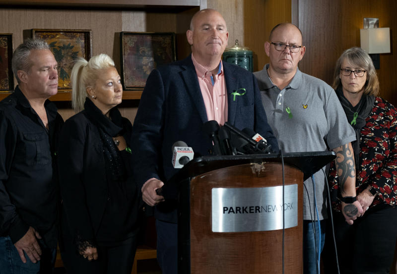 Radd Seiger, a spokesperson for the Dunn family, joins Charlotte Charles, center left, and Tim Dunn, center right, parents of Harry Dunn, who died after his motorbike was involved in an August 2019 accident in Britain with Anne Sacoolas, wife of an American diplomat, speaks at a news conference joined by Harry Dunn's step parents Bruce Charles and Tracey Dunn Monday, Oct. 14, 2019, in New York. The family is seeking answers after Sacoolas returned to the United States after being granted diplomatic immunity following the crash. (AP Photo/Craig Ruttle)