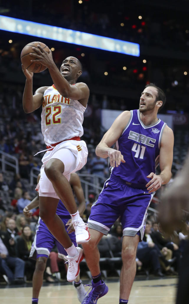 Atlanta Hawks guard Isaiah Taylor (22) goes to the basket as Sacramento Kings center Kosta Koufos (41) defends during the first half of an NBA basketball game Wednesday, Nov. 15, 2017, in Atlanta. (AP Photo/John Bazemore)
