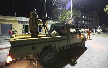 Somali government soldiers arrive at the scene of an explosion at the gate of Wehliya hotel in Somalia's capital Mogadishu
