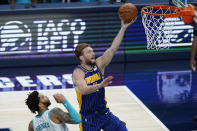 Indiana Pacers' Domantas Sabonis (11) shoots next to Charlotte Hornets' Miles Bridges during the second half of an NBA basketball Eastern Conference play-in game Tuesday, May 18, 2021, in Indianapolis. (AP Photo/Darron Cummings)