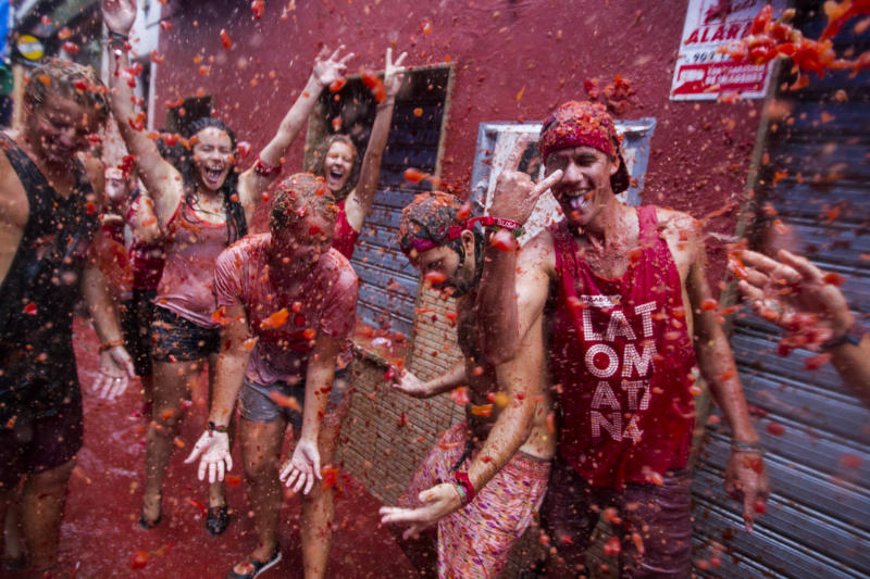 Revellers take part in the annual Tomatina festivities in Bunol, near Valencia, on August 28, 2013