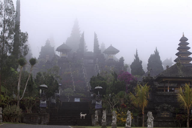 <p>Bali's most prominent temples, called Pura Besakih and located a few kilometers away from the mountain's slopes, are seen in the fog, Bali, Indonesia, Sept. 25, 2017. More than 35,000 people have fled a menacing volcano on the Indonesia tourist island of Bali, fearing will erupt for the first time in more than half a century as increasing tremors rattle the region. (AP Photo/Firdia Lisnawati) </p>