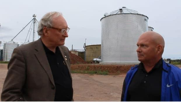 Former P.E.I. Premier Wade MacLauchlan, left, interviews Chris Chivilo, of W.A. Grain, in this October 2018 video. W.A. Grain, which operated New Leaf Essentials in Slemon Park, has gone into receivership