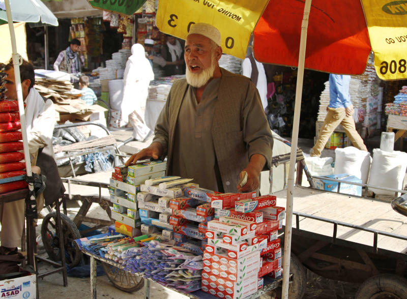In this Thursday, Sept, 26, 2013 photo, Abdul Wasay, 75, sells toothbrushes and toothpaste on a busy street market In Kabul, Afghanistan, where he says he usually spends most of his days. In a country with no pension system for people not in government service, it's a hard life for the former blacksmith and cook. He makes just $6 a day and it's barely enough to help support his wife. (AP Photo/Ahmad Jamshid)