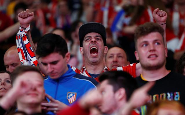 Soccer Football - Europa League Final - Atletico Madrid fans watch the final - Olympique de Marseille vs Atletico Madrid - Wanda Metropolitano, Madrid, Spain - May 16, 2018 Atletico Madrid fans celebrate winning the final REUTERS/Juan Medina