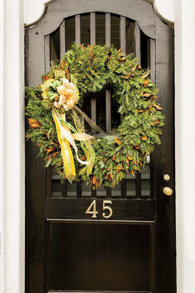 <p>Why choose just one? The combination of magnolia leaves and greenery create a festive front door display.</p>