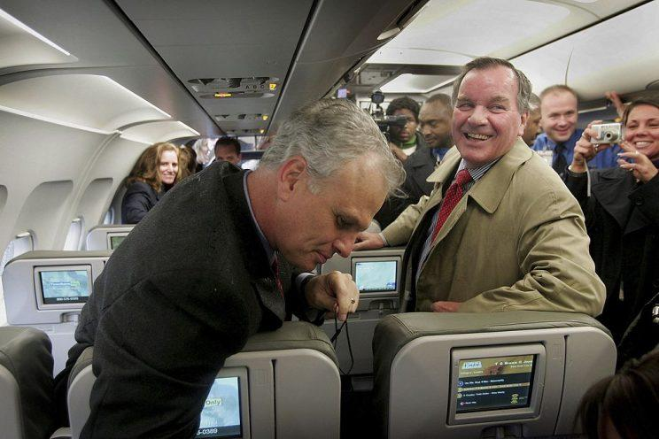 David Neeleman (L), Chairman and CEO of JetBlue Airways, shows Chicago Mayor Richard Daley (R) some of the features of a JetBlue aircraft at O'Hare Airport October 26, 2006 in Chicago, Illinois. (Photo by Scott Olson/Getty Images)
