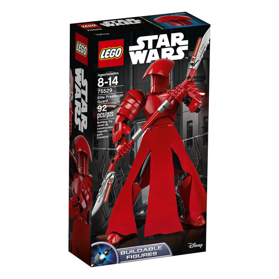 """<p>""""Protect the First Order with Supreme Leader Snoke's Elite Praetorian Guard. Reach for the awesome 2-handed bladed staff with lasers, or separate it to create 2 smaller weapons. Put this amazing guard dressed in tough red armor in a fearsome battle pose, then move the lever to swing the arms and send opponents running for cover!"""" $24.99 (Photo: Lego) </p>"""