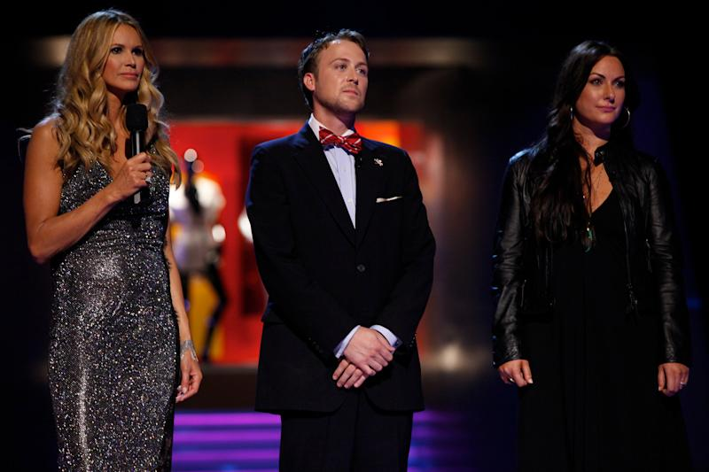 """In this undated image released by NBC, from left, host Elle Macpherson, Ross Bennett and Sarah Parrott are shown during the premiere episode of """"Fashion Star,"""" airing Tuesday, March 13, 2012 at 9:30p.m. EST on NBC. """"Fashion Star,"""" has 14 unknown designers who will compete to have their creations sold each week at  Saks Fifth Avenue, Macy's and H&M.  The winner will get $6 million in orders from all three combined.  (AP Photo/NBC, Tyler Golden)"""