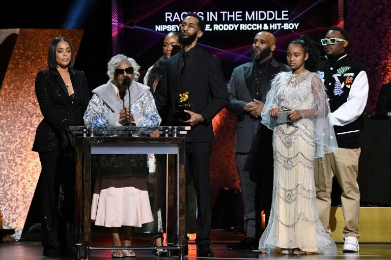 "Samiel Asghedom (C), brother of late US rapper Nipsey Hussle, his grandmother (2nd L), and other relatives accept the award for Best Rap Performance for ""Racks in the Middle"""