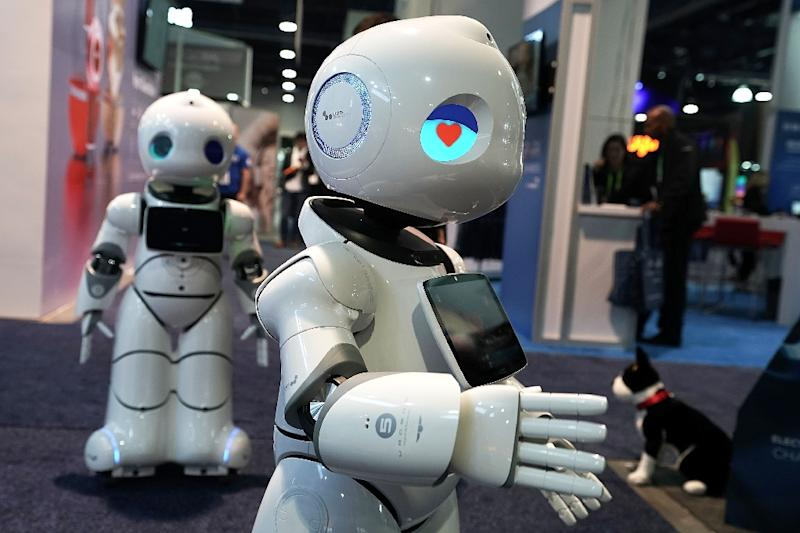 Robots are taking over millions of industrial jobs and now gaining in services, a trend that helps the overall economy but may worsen inequality, a new study finds (AFP Photo/ALEX WONG)