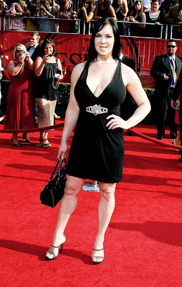 "Retired professional wrestler Chyna put her ample assets on display in a low-cut black dress. Jeffrey Mayer/<a href=""http://www.wireimage.com"" target=""new"">WireImage.com</a> - July 16, 2008"