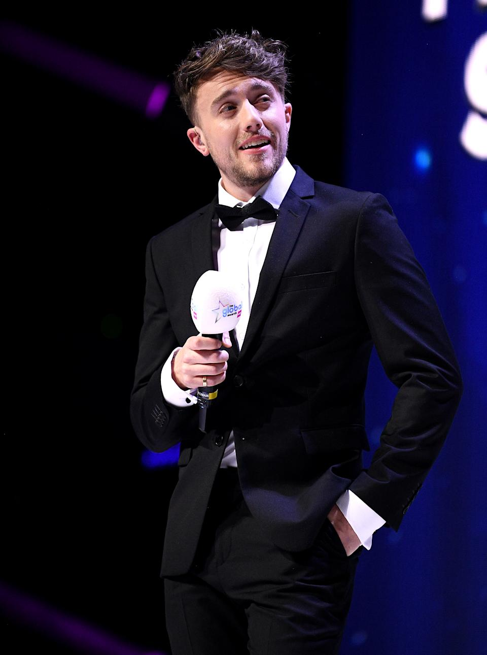 Host Roman Kemp on stage at the Global Awards 2020 with Very.co.uk at London's Eventim Apollo Hammersmith.