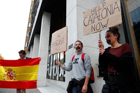Protesters demonstrate outside the venue where Former Catalan President Carles Puigdemont held a news conference in Brussels